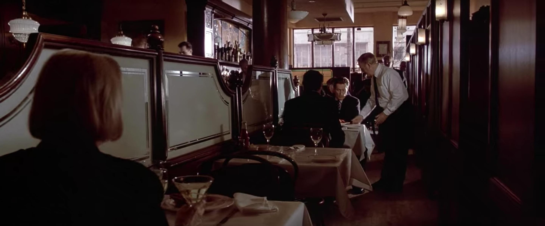 Bateman being interrogated over lunch.