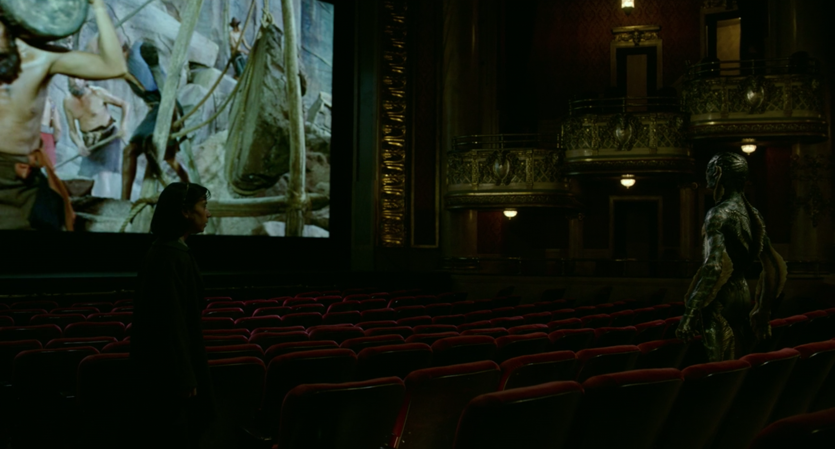 Elisa tracks down the amphibian man in the theatre.