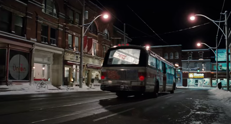 Bus drives along Carlton St.
