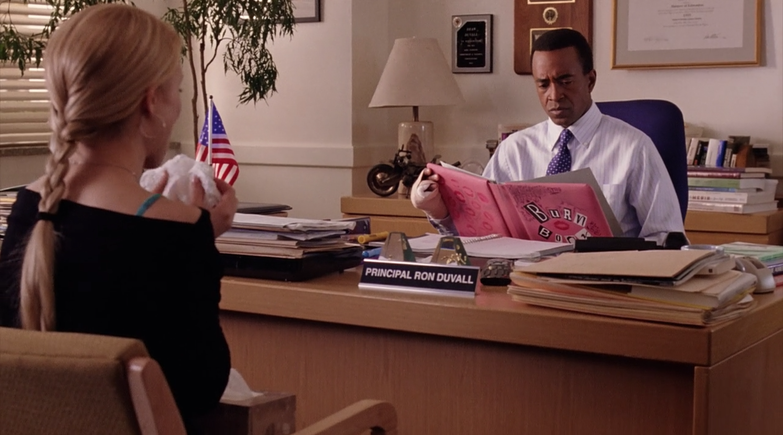 Regina tells the Principal Duvall about the burn book.